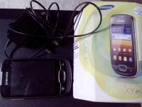 Samsung Galaxy GT-S5570i dobozában töltővel, hozzávaló fülessel.